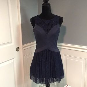 BCBG Navy body con and lace dress